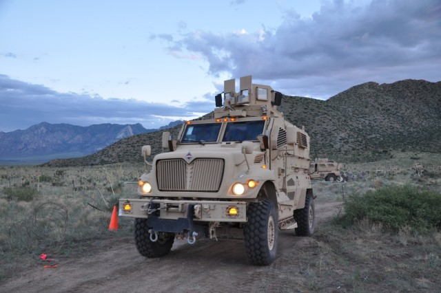 MRAPs roll on an early morning patrol of Mountain Village.