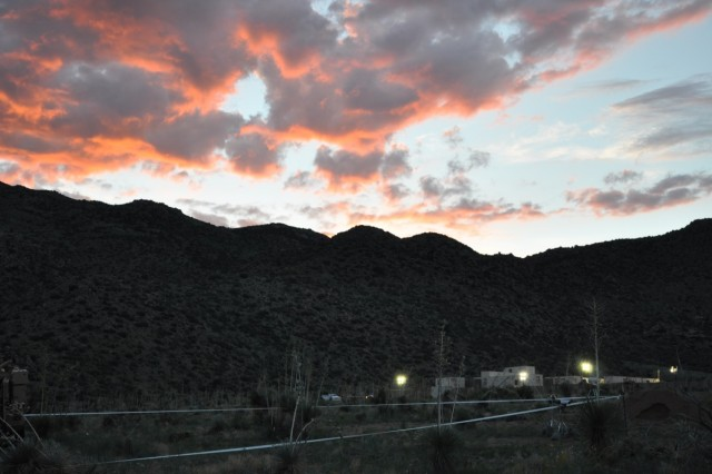 A sunset over Mountain Village in White Sands training area.