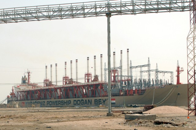 The Turkish Dogan Bey power ship sits moored in the southern port of Umm Qasr.  The ship provides enough power to run a small Iraqi city.  Currently, it feeds into the main Iraqi power grid.
