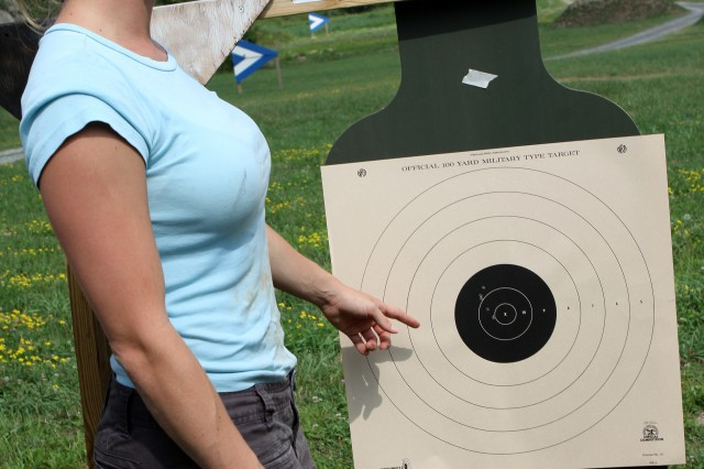 Megan Helf, research assistant in the Army Center for Enhanced Performance, shows off her five shots from an M-4 assault rifle in the target area. The event was coordinated by the Department of Military Instruction to allow the West Point community to familiarizes themselves with the training that cadets go through during summer training.