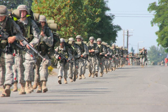 Army ROTC cadets participate in a 10-kilometer road march while attending the Leader Development and Assessment Course at Joint Base Lewis-McChord in early June.