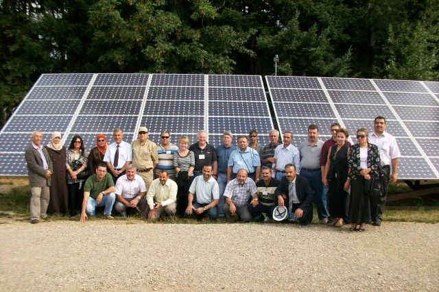 The Iraqi and U.S. delegation members pose at the Oregon Solar Highway Project in Portland, Ore., during their Aug. 2009 visit.