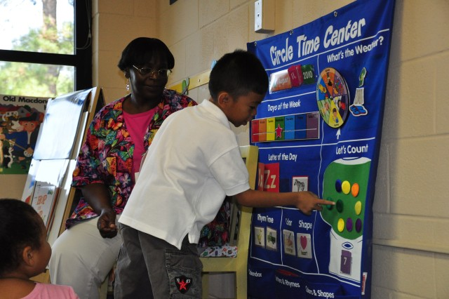 Instructor Dorothy Salley helps Mario Umel, 5, count gumballs to solve a math problem during Kindergarten Boot Camp Wednesday. Umel will be entering Kindergarten at Pierce Terrace Elementary School next week. Kindergarten Boot Camp teaches children basic reading, writing and math skills to help them be successful as they prepare to enter elementary school.