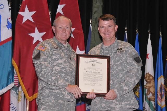 Gen. Martin Dempsey, TRADOC Commanding General, presents a certificate of promotion to Brig. Gen. Paul E. Funk II.