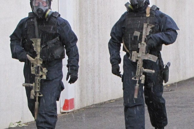 Massachusetts Special Tactical and Operations Operators prepare for training in APPS Chemical Biological Radiological and Nuclear Personal Protective Equipment.