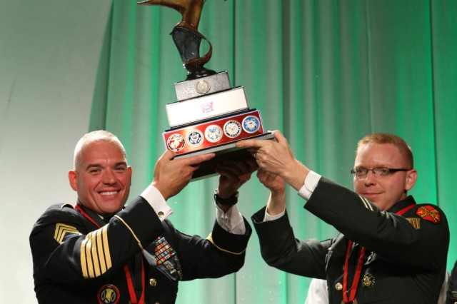 Sgt. 1st Class Rene Marquis, left, and Sgt. Matthew Flemister hoist a trophy after winning the Freedom Chef Challenge held during the 2010 American Culinary Federation in Anaheim, Calif., Aug. 3.