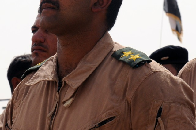 An Iraqi Army officer stands proud in formation Aug. 12 at the Besmaya Combat Training Center, Iraq during a Tank Familiarization Course graduation. Around 500 Iraqi Army soldiers have graduated the class so far.
