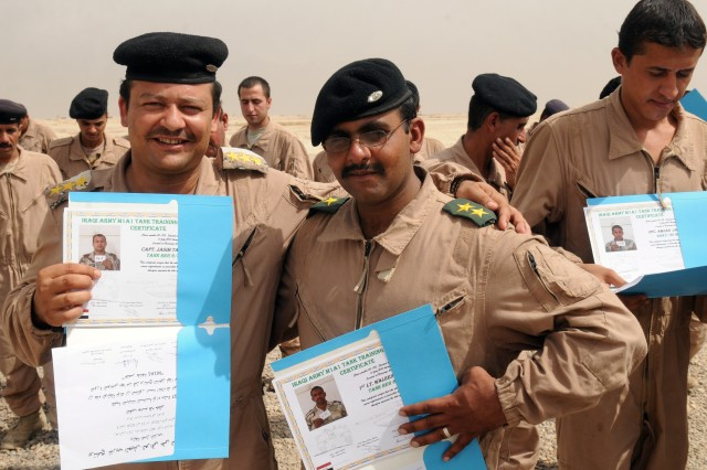 Iraqi Army officers proudly display their certificates of graduation Aug. 12 at the Besmaya Combat Training Center, Iraq after a Tank Familiarization Course graduation. Around 500 Iraqi Army soldiers have graduated the class so far.