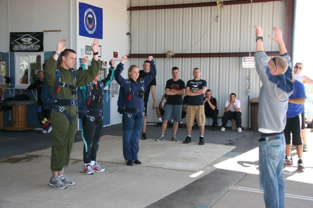 FORT CARSON, Colo. - Soldiers from 52nd Engineer Battalion, 555th Engineer Brigade, go through final jump instruction at the Freemont County Airport Aug. 5, before flying to 4,000 feet altitude and making their first static-line jump.