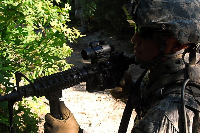 FORT HOOD, Texas-Pvt. Aaron Gazar, from Flagstaff, Ariz., an infantryman with 1st Battalion, 8th Cavalry Regiment, 2nd Brigade Combat Team, 1st Cavalry Division, pulls security while his squads halts during rehearsal for squad live-fire training, here, Aug. 10.