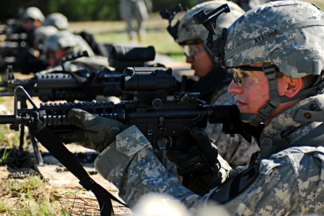 FORT HOOD, Texas-Pvt. Kyle Brock, from Ahoskie, N.C., an infantryman with 1st Battalion, 8th Cavalry Regiment, 2nd Brigade Combat Team, 1st Cavalry Division, looks downrange for targets during rehearsal for squad live-fire training on Fort Hood, Texas, Aug. 10.