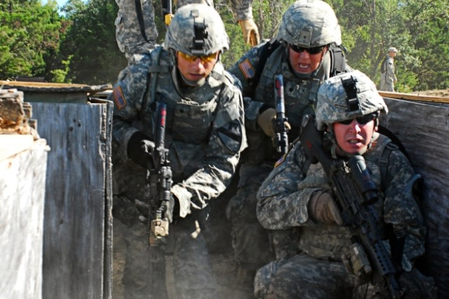 FORT HOOD, Texas-Infantrymen from 1st Battalion, 8th Cavalry Regiment, 2nd Brigade Combat Team, 1st Cavalry Division, prepare to clear a trench during rehearsal for squad live-fire training on Fort Hood, Texas, Aug. 10.