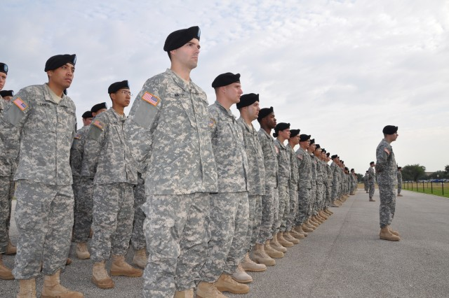 This year's Basic Officer Leadership Course class of 482 students stand at parade rest during the July 26 graduation ceremony. The BOLC is required for every Army officer.