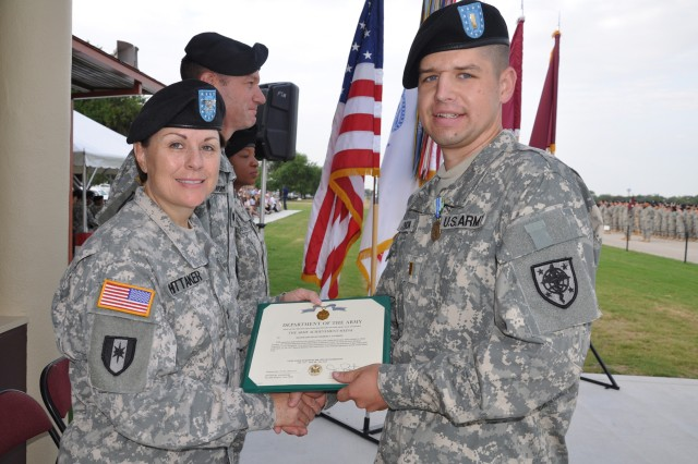 Col. Donna Whittaker awards 2nd Lt. Robert Atchison an Army Achievement Medal for his meritorious achievement as the recipient of the Lynch Leadership Award during his attendance at BOLC.