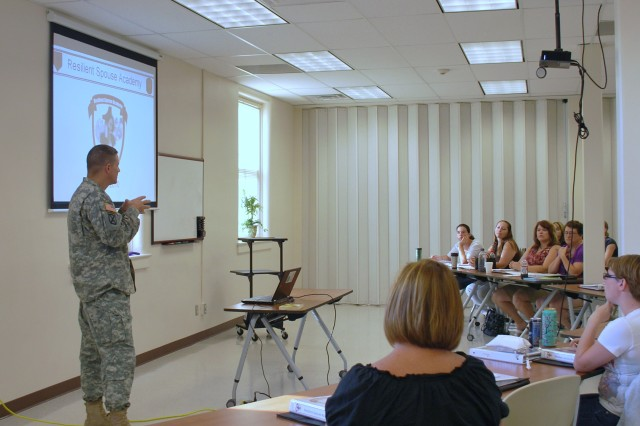 Col. Kevin Brown, Fort Riley garrison commander, explains the important role spouses play in detecting early warning signs of stress in their Soldier during a Resilient Spouse Academy Aug. 10 to 13 at Fort Riley, Kan. The Resilient Spouse Academy taught spouses skills to cope with finances, domestic violence and suicide prevention.