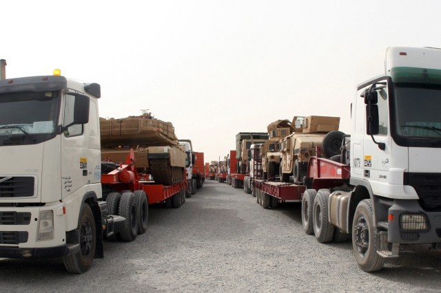 A convoy of armored vehicles from Iraq arrives at the Shuaiba Port in Kuwait, July 22. The 1185th Deployment Distribution Support Battalion orchestrates the transportation of the vehicles, which will board the Motor Vessel Liberty for shipment back to the U.S. Port operations are essential to 1st TSC's smooth and efficient drawdown of equipment from Iraq.