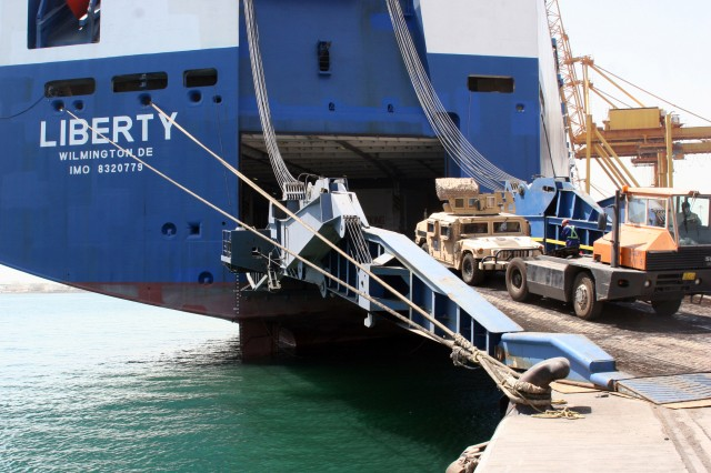 A driver loads a non-operational Humvee from Iraq onto the Motor Vessel Liberty at Shuaiba Port, Kuwait. The Liberty will carry 6,000 tons of military cargo from the port to the United States. Port operations, managed by 595th Transportation Brigade, are essential to 1st Theater Sustainment Command's efficient drawdown of equipment from Iraq.
