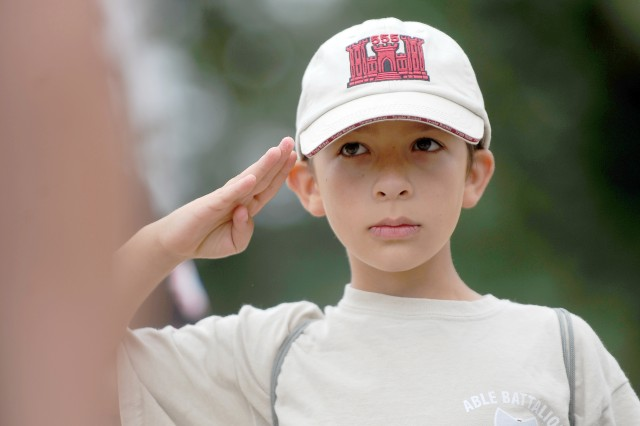 Drew Johnson, 9, salutes during the deployment camp. The camp gave kids a closer look at what their Soldier-parent does on a daily basis by teaching them the basics of Soldiering and by sending them on a mock deployment.