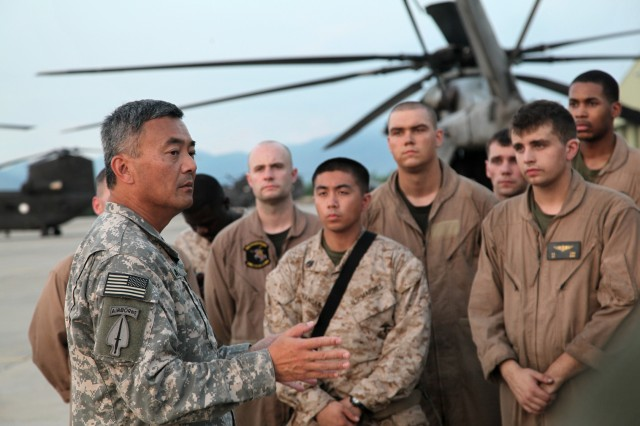Brig. Gen. Michael Nagata welcomes U.S. Marines who are replacing the 3rd Combat Aviation Brigade in the delivery of humanitarian assistance and with the evacuation of flood victims as part of the flood disaster recovery effort in Khyber Pakhtunkhwa province of Pakistan, Aug. 13, 2010. The Marines are assigned to the 15th Marine Expeditionary Unit.