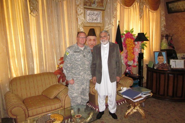 KUNAR PROVINCE, Afghanistan - Col. Craig Bargfrede, commander of Iowa National Guard's 734th Agri-Business Development Team, meets with Gov. Syed Fazlullah Wahidi at the governor's compound in the Asadabad district, Kunar province, Aug. 10. Bargfrede is an Ankeny, Iowa, native. (Photo by U.S. Army Capt. Peter Shinn, 734th Agri-Business Development Team)