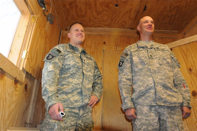 Sgt. Ryan M. Lahr (left), a native of Estherville, Iowa, and certified occupational therapy assistant, Mild Traumatic Brain Injury Clinic, 626th Brigade Support Battalion, 3rd Brigade, 101st Airborne Division, uses a Wii game system to administer balance exercises to Sgt. 1st Class James R. Jones, platoon sergeant for 1st Platoon, Troop B, 133rd Calvary Regiment.  Jones was recently involved in an insurgent attack and had a rocket-propelled grenade explode in the air just a few feet from him, knocking him unconscious.