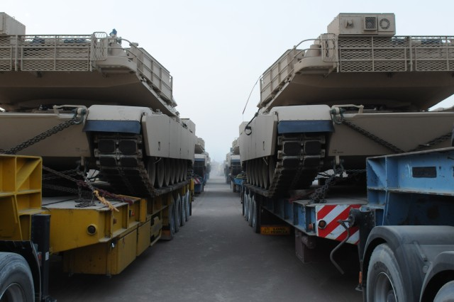 In accordance with a sales agreement between the U.S. and Iraqi governments, contractors deliver 11 M1A1 Abrams tanks to the Iraqi Army Aug. 12 at Forward Operating Base Hammer, Iraq. Tanks will be transferred to Iraqi control at the Besmaya Combat Training Center and will be used to strengthen the 9th Armored Division.