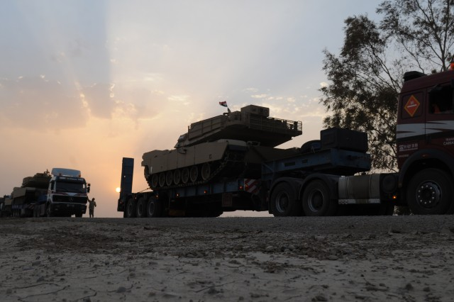 In accordance with a sales agreement between the U.S. and Iraqi governments, contractors deliver 11 M1A1 Abrams tanks to the Iraqi Army Aug. 12 at Forward Operating Base Hammer, Iraq. This transport is the first of 140 M1A1 tanks to reach the Iraqi Army.
