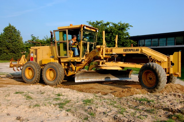 Billy Long, a motor grader operator and Goldsboro, N.C. native, keeps a watchful eye as he prepares the area in front of Fort Bragg, N.C.'s Old Bowley School for landscaping, August 13, 2010. The school is being renovated to serve as temporary workspace during the relocation here by the headquarters of FORSCOM and U.S. Army Reserve Command, as directed by the 2005 Base Realignment and Closure legislation. The command's Advance Echelons will begin arriving on Oct. 1 and the main elements will move here beginning in March. The relocation will be complete by late summer 2011.