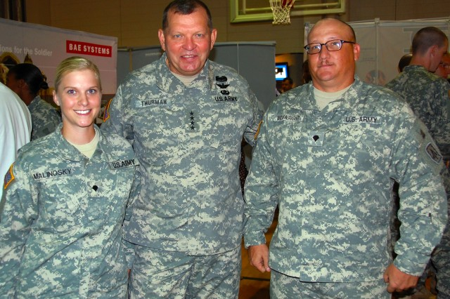 General James D. Thurman, commanding general, U.S. Army Forces Command, pauses for a photo with Spec. Donald Wainwright and Spec. Ashley Malinosky during the 2010 Defense and Economic Development Trade Show, Aug. 10, 2010, at Fayetteville, NC. Wainwright, from Prattville, Ala. and Malinosky, of Waynesboro, Pa. are Patriot Missile crewmembers assigned to 3rd Battalion, 4th Air Defense Artillery Regiment, Fort Bragg, N.C.