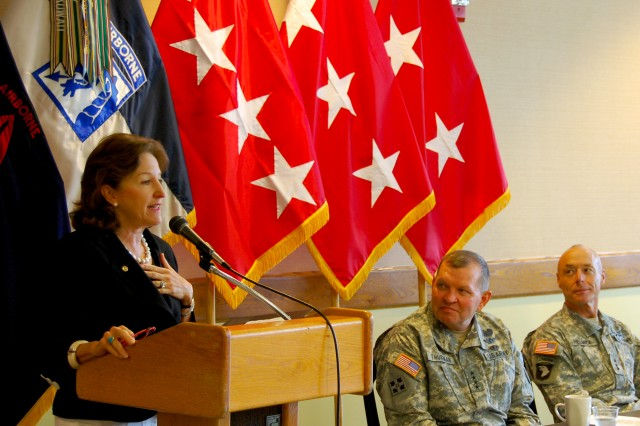 U.S. Senator Kay Hagan, N.C., addresses the audience during the opening breakfast of the 2010 Defense and Economic Development Trade Show, Aug. 10, 2010, at Fayetteville (N.C) Technical Community College. General James D. Thurman, commanding general, U.S. Army Forces Command and Lt. Gen. Frank G. Helmick, commanding general, XVIII Airborne Corps and Fort Bragg, listen as Hagan details the accomplishment of Fort Bragg Soldiers and units over the past 18 months.