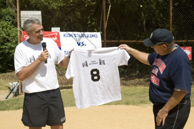 PICATINNY ARSENAL, N.J. - Brig. Gen. Jonathan Maddux presents a custom made Team Picatinny t-shirt to Larry Berra with his father's number on it.  Number 8 has been retired by the New York Yankees since 1972.