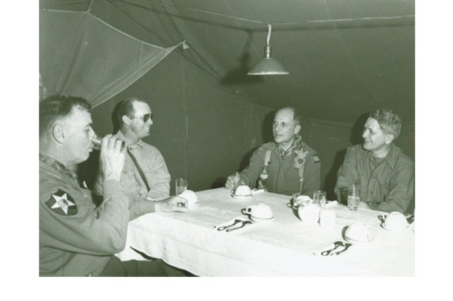 Ridgway in Korea: In this image General Ridgway is in Korea, one month after relieving General MacArthur as Supreme Allied Commander. Shown with him are (L-R)LTG James A Van Fleet , Colonel John Chiles, General Ridgway, and Ambassador William Sebald. (Ridgway Photograph Collection)