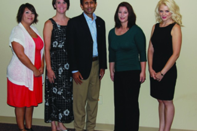 Seen here from left are Army spouse Jennifer Walker, Army spouse Jennifer Benca, Louisiana Gov. Bobby Jindal, Army spouse Mellisa Gaul and Army spouse Diana Veseth-Nelson prior to a press conference in Alexandria Aug. 12 announcing National Electronic Warranty Inc.'s decision to create 200 new home-based jobs in the Fort Polk area.