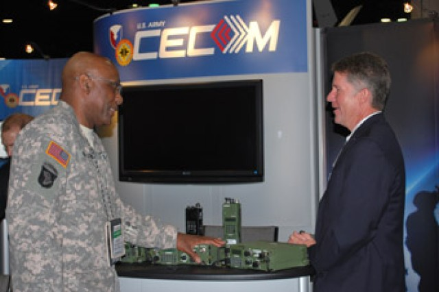 James R. Snyder, logistics data specialist at the Logistics and Readiness Center, discusses current needs concerning commercial-off-the shelf radios with Chief Warrant Officer Richard B. Montgomery, communications officer with the Army National Guard Bureau, during the 2010 LandWarNet Conference in Tampa earlier this month.