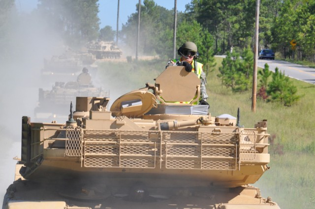 Five M1A2 Abrams System Enhancement Package tanks roll along the tank trail Aug. 11 that parallels Old Cusseta Road.