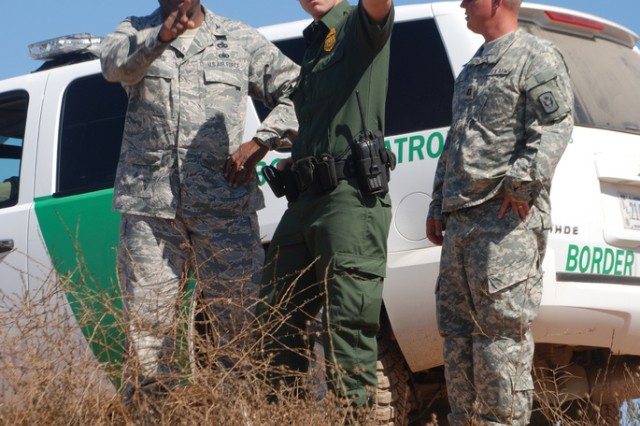 Air Force Col. Nate Reddicks, left, the commander of the California National Guard's Joint Task Force Sierra, J. Zimmerman, a Customs and Border Protection agent from the Chula Vista station in California, and Army Capt. Daniel Fox, the field operations company commander for the task force, tour the San Ysidro Mountains on Aug. 4, 2010. The California Guard and CBP are working together to secure the state's border.