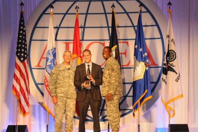 Justin Filler, deputy director of MilTech Solutions, (center) accepted the 2010 Army Knowledge Management Award in the technology category from Lt. Gen.Jeffrey A. Sorenson, chief information officer/G-6, (left) while CIO/G-6 Command Sgt. Maj. Donald G. Manely (right) stood by.