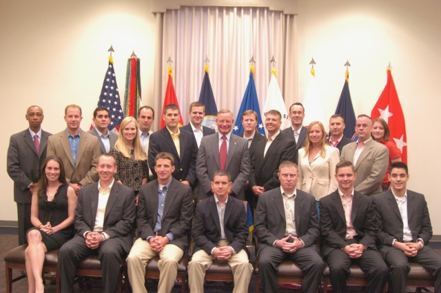 Mr. Egon Hawrylak, Joint Force Headquarters and The U.S. Army Military District of Washington, deputy commander, stands in the center with the new members of the Army Congressional Fellowship Program during their visit to Ft. McNair Aug. 13.  The purpose of the Army Congressional Fellowship Program is to educate and train selected Army officers and civilians in all aspects of congressional activities.  The Army Congressional Fellowship program is three and a half years long and includes pursuit of a Master's Degree in Legislative Affairs.