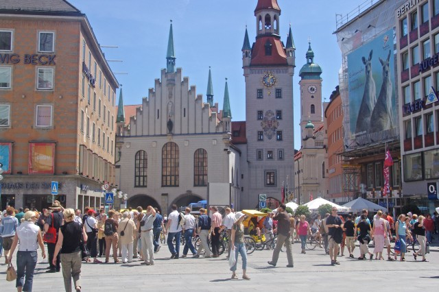 Pedestrians browse through Marienplatz in Munich. The square sits at the tail end of Munich's popular Kaufinger Strasse shopping district.