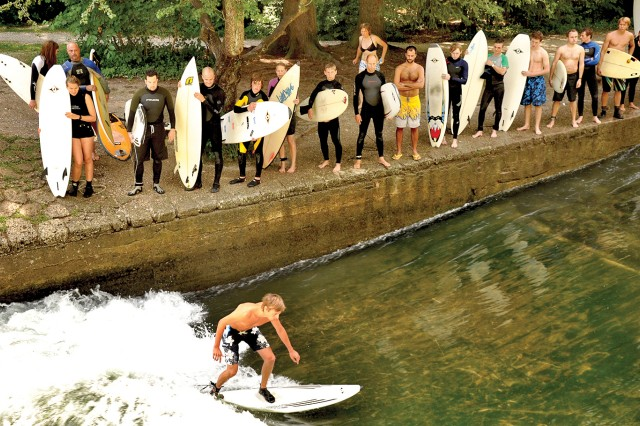 Land-locked Munich may be quite a ways from ocean waves, but surfers still manage to get some practice in on a canal off of the Isar River.