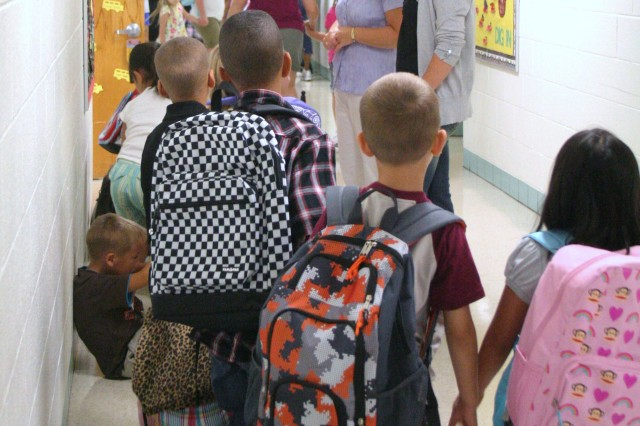Students line up in the hall way of Jefferson Elementary School, Fort Riley, Kan., before entering their classroom Aug. 17. The first day of school for Fort Riley students in the Geary County Unified School District 475 was Aug. 16.