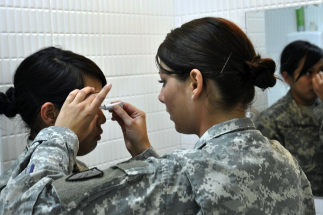 Sgt. Tara Gardner applies ointment to the eye of her patient, Pfc. Karina Paraoan, at Five Hills Training Area outside Ulaanbaatar, Mongolia Aug. 16. Gardner is a medic with the Alaska Army National Guard's Medical Detachment and Paraoan is a public affairs specialist with the Alaska Army National Guard's 134th Public Affairs Detachment. Both serve at Camp Denali, Fort Richardson, Alaska. Gardner is currently providing medical support for participants from both the U.S and Mongolia participating in Khaan Quest 2010. Gardner said because there were a lot of athletes within the ranks at the command post exercise, she saw several patients for muscle aches and pains from running and hiking in the mountains. She also treated sinus problems, tooth pain, scrapes and cuts, eye pain, skin infection and dehydration.