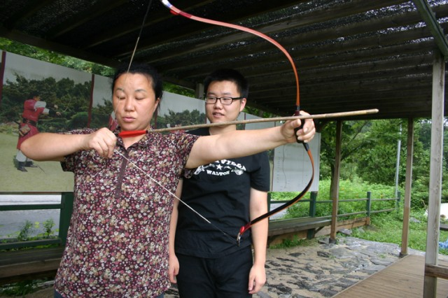 "PAJU, South Korea - A staff member at the Youngjip Bow and Arrow Museum in Paju demonstrate the proper method to hold the weapon. The Youngjip Bow and Arrow Museum is the first of its kind in Korea dedicated to archery. Bow and arrow making called ""gangsi jang"" has been designated as Korean Intangible Cultural Asset No. 47."