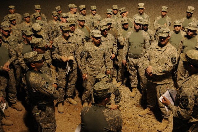 Soldiers with Company F, 52nd Infantry Regiment, 2nd Battalion, 12th Field Artillery Regiment, 4th SBCT, 2nd Infantry Division, listen to a convoy brief Aug. 16 at Contingency Operating Base Adder, Iraq, before their final convoy out of theater. The 4th SBCT is the last combat brigade to leave Iraq.