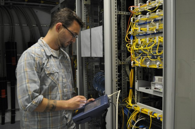 Robert J. Lucas, network manager, 69th Signal Battalion, Operations Center Bamberg, uses a Fluke Network Analyzer. The device is used to detect and locate rogue wireless access points on base, and to scan the base network traffic for unauthorized machines and other network anomalies.