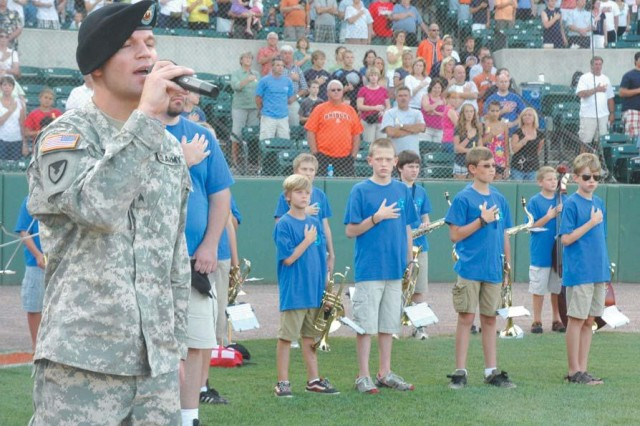 Sgt. Anthony Gentilo, from the U.S. Army Materiel Command Band, sings the national anthem during the pre-game festivities for Ripken Stadium's Military Appreciation Night, July 30.
