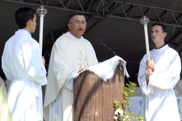 Chaplain (Maj.) Angel Sanchez, Villalba, Puerto Rico, Multinational Battle Group East, reads the Gospel during a Mass celebrating the Assumption of the Blessed Virgin Mary, Aug. 15 in Letnica/Letnice, Kosovo. Sanchez was one of several dozen U.S. soldiers who hiked through the Karadak hills as part of a pilgrimage to the church where Mother Teresa received her calling. The American troops who participated this year included National Guard Soldiers from Puerto Rico, Arkansas, Iowa and Connecticut, as well as Army Reserve soldiers from Georgia. They are deployed to Kosovo in support of KFOR 13.