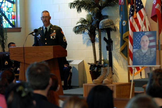 FORT HOOD, Texas - Staff Sgt. Douglas Garn, from Manton, Mi., assigned to C Company, 3rd Brigade Combat Team Special Troops Battalion, 1st Cavalry Division, addresses Soldiers and friends during a memorial service for Staff Sgt. Bradley Penman at Fort Hood's Memorial Chapel, Aug. 17.
