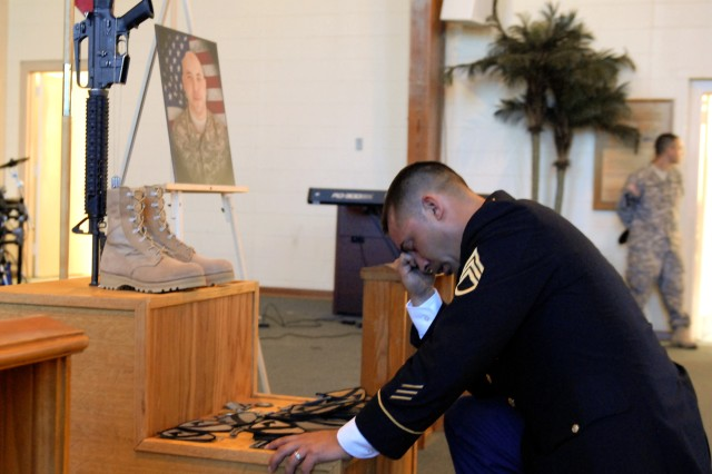 FORT HOOD, Texas - Staff Sgt. Karl Akama, from Honolulu, a platoon sergeant with C Company, 3rd Brigade Combat Team Special Troops Battalion, 1st Cavalry Division, takes a knee and has a moment of silent in front of Staff Sgt. Bradley Penman's memorial during Penman's memorial service at Fort Hood's Memorial Chapel, Aug. 17.