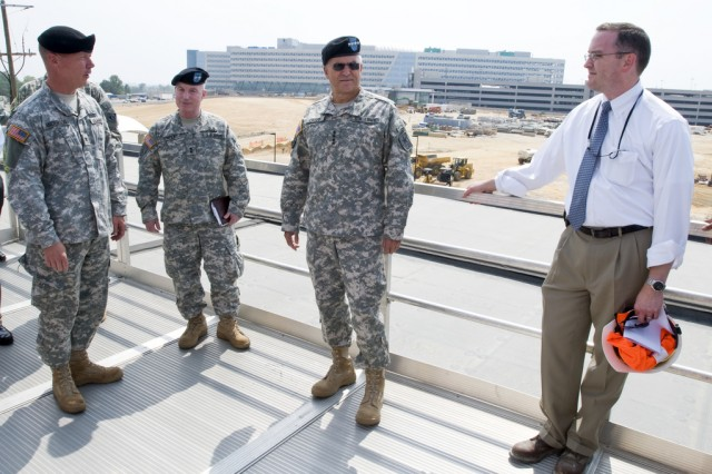 Army Chief of Staff Gen. George W. Casey Jr. speaks to members of the U.S. Army Corps of Engineers and the National Geospatial-Intelligence Agency (NGA) Campus East project team during a visit to the Integrated Program Office (IPO), Aug. 11, 2010. The general visited the IPO and NGA Campus East project site to observe construction progress of the $1.7 billion project which is being completed as part of 2005 Base Realignment and Closure programs here. The U.S. Army Corps of Engineers Baltimore District, along with NGA, is managing design and construction of the project.